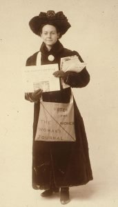 Florence Luscomb selling copies of The Women's Journal