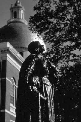 Anne Hutchinson Statue with State House dome in background